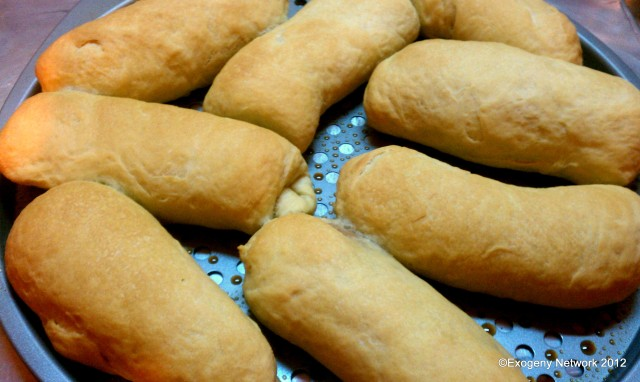 Hot dogs wrapped in bread dough and baked until golden brown.